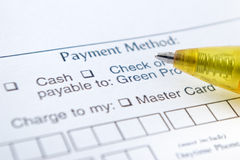 Payment Method. Application and yellow pen Stock Image