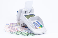 Payment method. Credit card machine with banknotes isolated on white stock image