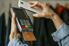 Payment with mobile phone Stock Image