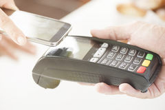 Payment. NFC - Near field communication, mobile payment Stock Photos