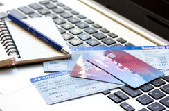 Payment online concept with cards and tickets on laptop. Payment online concept with credit cards and flight tickets on laptop keyboard background Stock Photos
