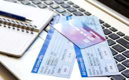 Payment online concept with cards and tickets on laptop. Payment online concept with credit cards and flight tickets on laptop keyboard background Royalty Free Stock Image