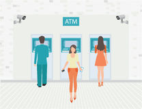 Payment options banking finance money. Payment options banking finance money, Businessman and woman doing ATM machine money deposit or withdrawal, conceptual Royalty Free Stock Image