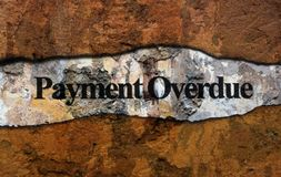Payment overdue text on wall royalty free stock image