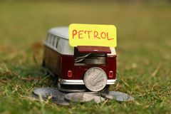 Payment for the Petrol concept. Price. Payment for the Petrol concept. Car loaded with money for the Petrol payment royalty free stock photo
