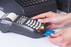Payment for purchase by  cash register and credit card reader. Stock Photography