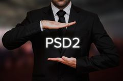 Payment Services Directive 2 PSD2. Concept with businessman and text between his hands on blurry bokeh background Royalty Free Stock Photo
