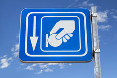 Payment signal. Blue metal pay here parking signal with sky background Royalty Free Stock Images