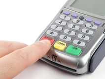 Payment terminal. With keypad and a finger pressing red STOP button Royalty Free Stock Photos