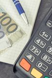 Payment terminal for cashless paying in different places, notepad and currencies euro. Payment terminal using for cashless paying in different places, notepad royalty free stock photo