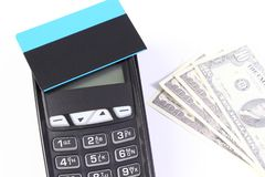 Payment terminal with contactless credit card and currencies dollar, cashless paying for shopping concept. Payment terminal with contactless credit card and Stock Image