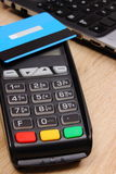 Payment terminal with contactless credit card and laptop, finance concept Stock Photography