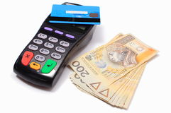 Payment terminal with contactless credit card and money Royalty Free Stock Image