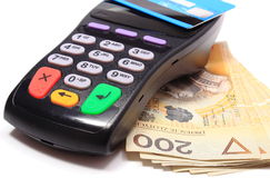 Payment terminal with contactless credit card and money Stock Images