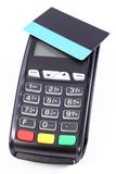 Payment terminal with contactless credit card on white background, cashless paying for shopping, finance concept Royalty Free Stock Images