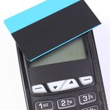 Payment terminal and credit card, cashless paying for shopping or products Stock Images