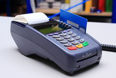 Payment terminal with credit card on desk in shop. Payment terminal with credit card on desk in store, credit card reader, payment terminal, finance concept Stock Images