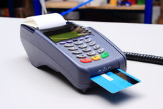 Payment terminal with credit card on desk in shop Stock Image