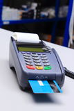 Payment terminal with credit card on desk in shop Royalty Free Stock Photos