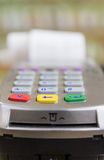 Payment terminal. Credit Card Terminal or EDC on cashier table in the store have Royalty Free Stock Image