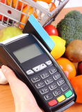 Payment terminal with credit card and fruits and vegetables, cashless paying for shopping. Using credit card reader, payment terminal with credit card and fresh Stock Images