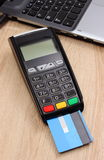 Payment terminal with credit card and laptop, finance concept Royalty Free Stock Images
