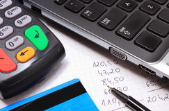 Payment terminal with credit card, laptop and financial calculations Stock Photos