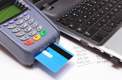 Payment terminal with credit card, laptop and financial calculations Stock Photo