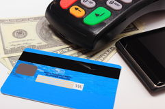 Payment terminal, credit card and mobile phone with NFC technology, money Stock Images