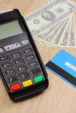 Payment terminal with credit card and money on desk, finance concept Royalty Free Stock Photo