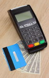 Payment terminal with credit card and money on desk, finance concept Stock Images