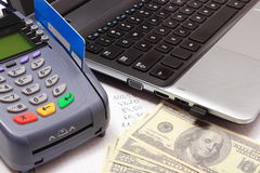 Payment terminal with credit card, money, laptop and financial calculations Stock Photos
