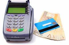 Payment terminal with credit card and money on white background Royalty Free Stock Photo