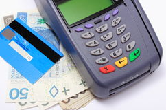 Payment terminal with credit card and money on white background Stock Photo