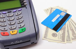 Payment terminal with credit card and money on white background Royalty Free Stock Image