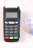 Payment terminal, credit card reader with currencies euro, cashless paying for shopping or products. Credit card reader, payment terminal with currencies euro Royalty Free Stock Photo