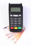 Payment terminal, credit card reader with currencies euro, cashless paying for shopping or products. Credit card reader, payment terminal with currencies euro Stock Photography