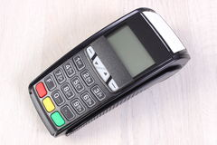 Payment terminal, credit card reader on wooden background, cashless paying for shopping, finance concept Stock Photography