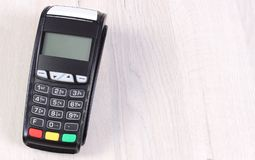 Payment terminal, credit card reader on wooden background, cashless paying for shopping. Or products, copy space for text or inscription on board Royalty Free Stock Images