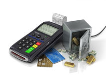 Payment terminal with credit card and safe with gold and money. Royalty Free Stock Image