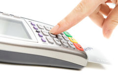 Payment terminal - a finger entering the PIN code Royalty Free Stock Photos