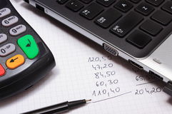 Payment terminal, laptop and financial calculations Royalty Free Stock Photo