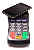 Payment terminal and mobile phone with NFC technology. Credit card reader, payment terminal, finance concept Stock Photo