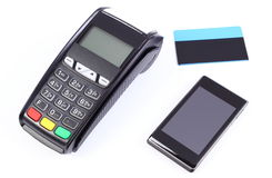 Payment terminal with mobile phone with NFC technology and credit card on white background, cashless paying for shopping Royalty Free Stock Images