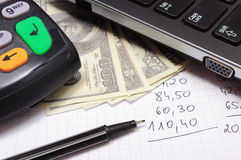 Payment terminal, money, laptop and financial calculations Royalty Free Stock Photography