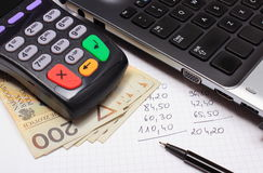 Payment terminal, money, laptop and financial calculations Stock Photo