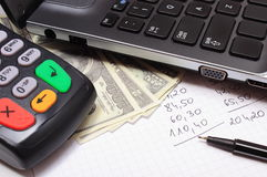 Payment terminal, money, laptop and financial calculations Stock Images