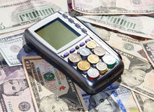 Payment terminal and money Royalty Free Stock Images