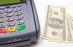 Payment terminal with money on white background Stock Image