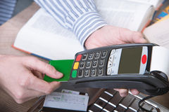 Payment terminal in the office. Laptop in the background Stock Photos